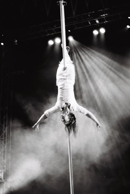 Laura Moy. photographer Eleanor Woodruff . flying pole . from FLOWN. at Glastonbury festival